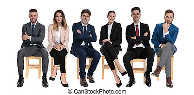 6 turstworthy businessmen smiling and looking forward while sitting