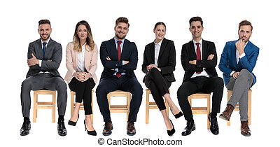 Team of 6 young businessmen smiling and looking forward