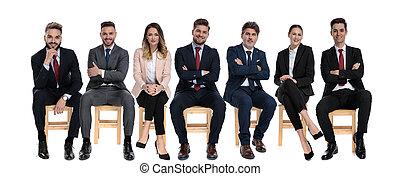 Team of 7 positive businessmen smiling