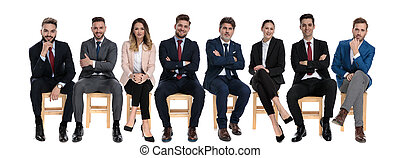 Team of 8 confident businessmen holding their arms crossed