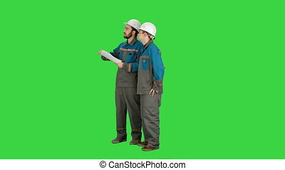 Team of architects people check documents on construciton site in group on a Green Screen, Chroma Key.