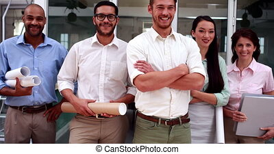 Team of architects smiling at camer