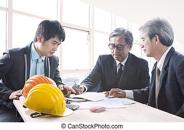 team of asian engineering man project solution discussing in office meeting room