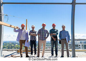 Team Of Builders On Costruction Site, Happy Smiling Foreman Group In Hardhat Outdoors Partnership And Teamwork Concept