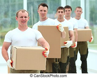 team of builders with boxes of building materials - foreman...