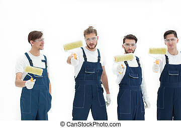 team of builders with paint rollers. isolated on white
