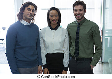 Team of business colleagues standing together in office