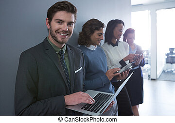 Team of business people using electronic devices