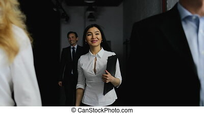 Team Of Business People Walking In Office While Asian...