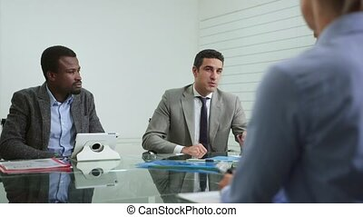 Team of business people working and talking during meeting in office room. 2of20