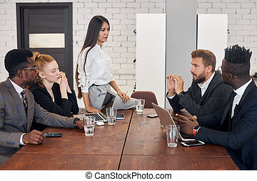 Team of businessmen in conference meeting of diverse people
