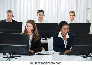 Team Of Businesspeople Working In Call Center