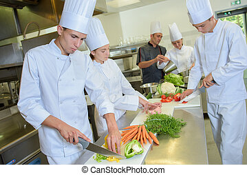Team of chefs preparing vegetables