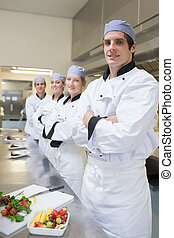 Team of Chef's standing in the kitchen
