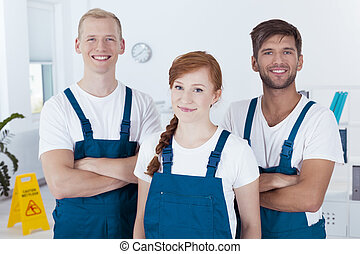 Team of cleaners - Team of smiling cleaners in an office