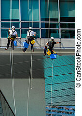 Climbing Workers On Office Building
