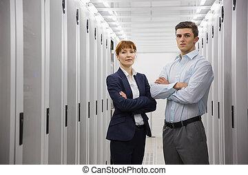 Team of computer technicians looking at camera