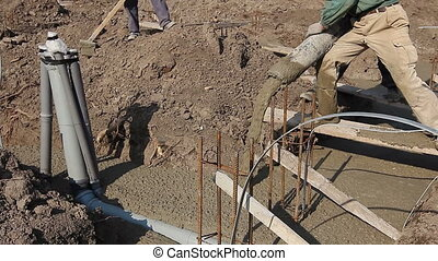 Team of construction workers are working on concreting at...