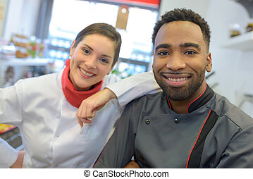 team of cooks in a commercial kitchen