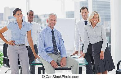 Team of cool business people posing
