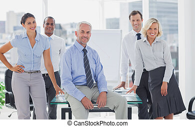 Team of cool business people posing