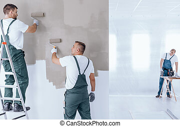 Team of coworkers doing renovation