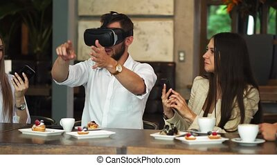 Team of developers working with virtual reality glasses during a business meeting. Young business colleagues brainstorming using VR goggles