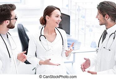 Team of different doctors having conversation