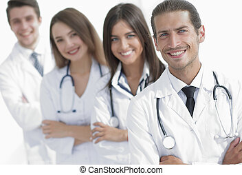 Team of doctors and nurses as colleagues in hospital. ...
