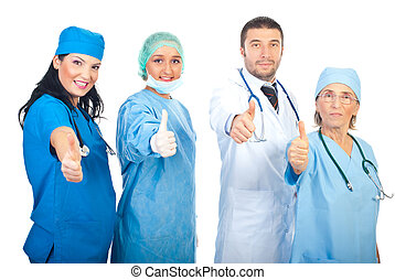 Team of doctors giving thumbs