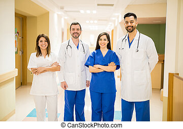 Team of doctors in a hospital hallway