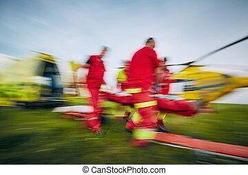 Team of emergency medical service in blurred motion