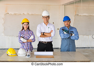 Team of engineers and technician Contractor or Constructor Standing in Building Construction site.