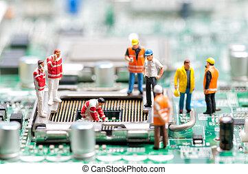 Team of engineers repairing circuit board. Computer repair...