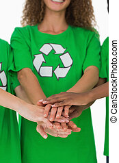 Team of environmental activists putting hands together