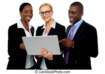 Team of friendly business people using laptop