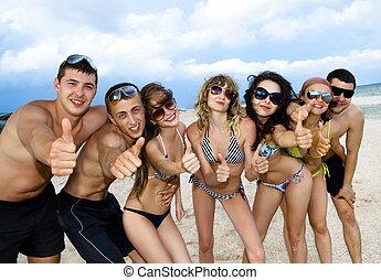 Team of friends having fun at the beach - Joyful team of...