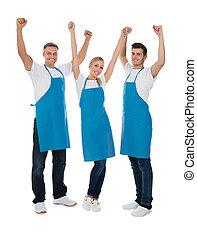 Happy Cleaners Raising Hands