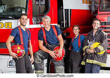 Team Of Happy Firefighters At Fire Station