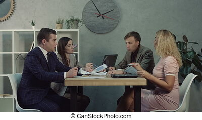 Team of managers discussing business strategies