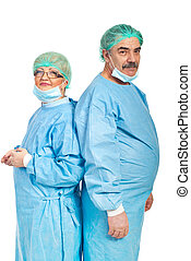 Team of mature surgeons