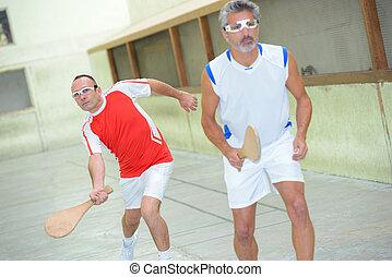 team of men playing basque squash