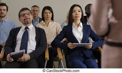 Team of multi ethnic business people at seminar - Diverse...