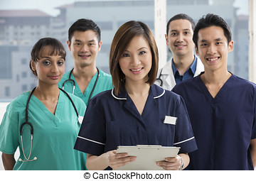 Team of Multi-ethnic medical staff - Nurses standing in a...