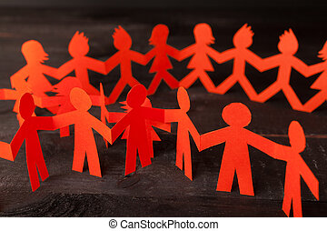 Team of paper doll people holding hands - Group of paper ...