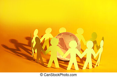 Team of paper doll people holding