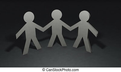 Team of paper dolls people holding hands and make circle...