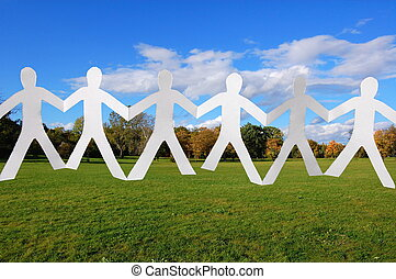 team of paper people in the park