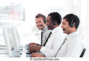 Team of People working in a call centre - Team of Young...