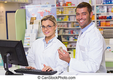 Team of pharmacists looking at camera at the hospital...